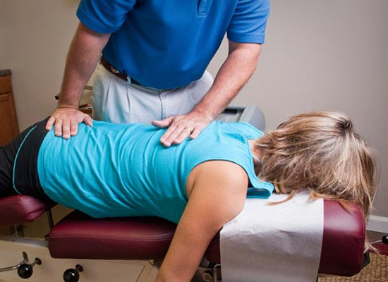 Chiropractor Jacksonville FL William Foland Prepping for Adjustment